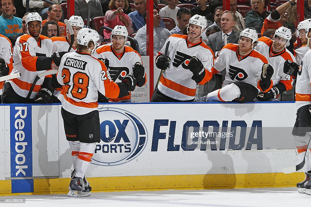 Claude Giroux #28 of the Philadelphia Flyers is congratulated by teammates after scoring a second period goal against the Florida Panthers at the BB&T Center on April 8, 2014 in Sunrise, Florida.
