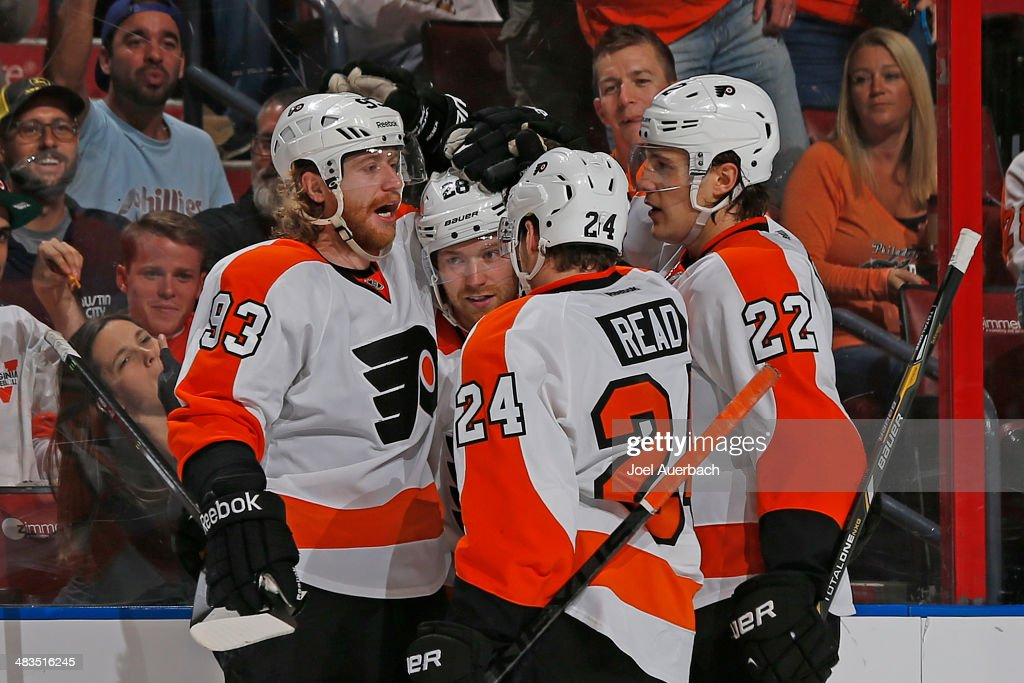Claude Giroux #28 of the Philadelphia Flyers is congratulated by teammates after scoring his first of two second period goals against the Florida Panthers at the BB&T Center on April 8, 2014 in Sunrise, Florida. The Flyers defeated the Panthers 5-2.