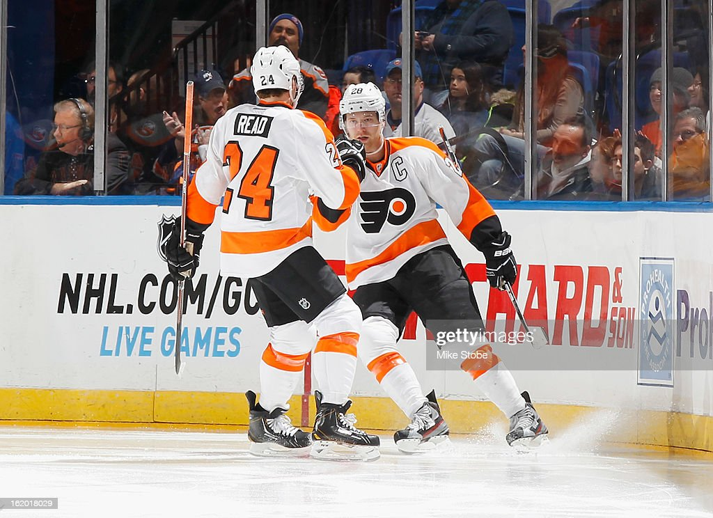 Claude Giroux #28 of the Philadelphia Flyers is congratulated by teammate Matt Read #24 on his first period goal during the game against the New York Islanders at Nassau Veterans Memorial Coliseum on February 18, 2013 in Uniondale, New York.