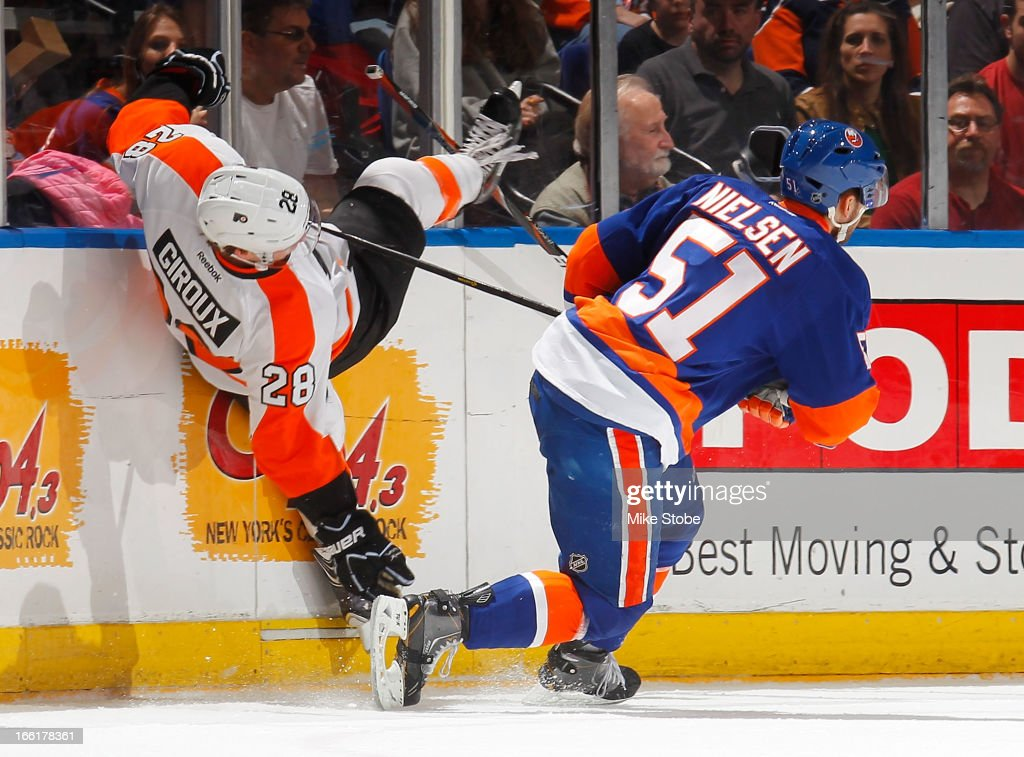 Claude Giroux #28 of the Philadelphia Flyers is tripped up by Frans Nielsen #51 of the New York Islanders at Nassau Veterans Memorial Coliseum on April 9, 2013 in Uniondale, New York.