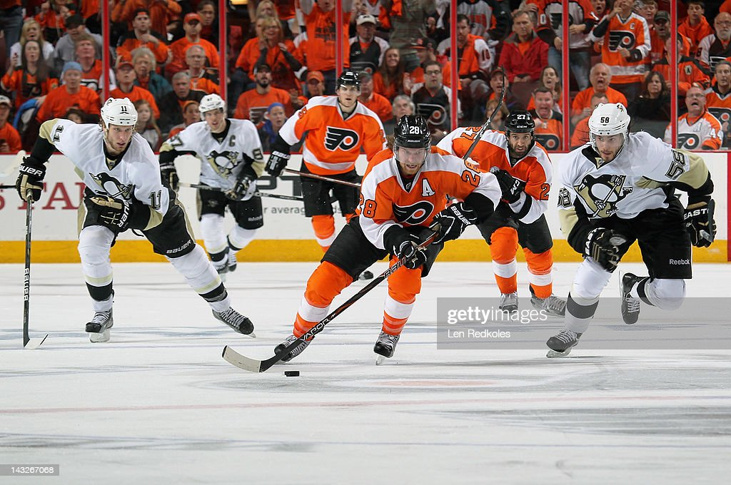 Claude Giroux #28 of the Philadelphia Flyers leads the rush up the ice while being trailed by Jordan Staal #11 and Kris Letang #58 of the Pittsburgh Penguins in Game Six of the Eastern Conference Quarterfinals during the 2012 NHL Stanley Cup Playoffs on April 22, 2012 at the Wells Fargo Center in Philadelphia, Pennsylvania. The Flyers defeated the Penguins 5-1 to win this series in six games.