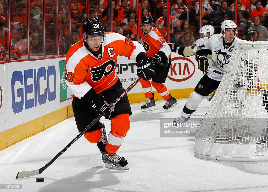 Claude Giroux #28 of the Philadelphia Flyers moves the puck against the Pittsburgh Penguins at Wells Fargo Center on January 19, 2013 in Philadelphia, Pennsylvania.