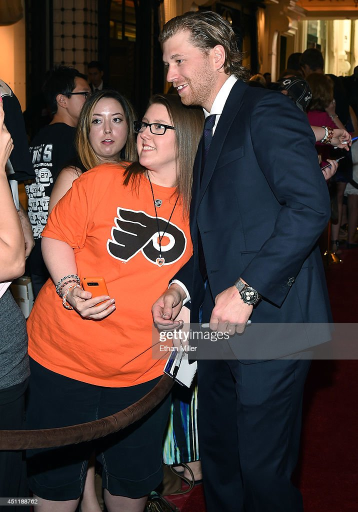 <a gi-track='captionPersonalityLinkClicked' href=/galleries/search?phrase=Claude+Giroux&family=editorial&specificpeople=537961 ng-click='$event.stopPropagation()'>Claude Giroux</a> of the Philadelphia Flyers (R) poses for a photo with Allison Lowe of Nevada as he arrives at the 2014 NHL Awards at Encore Las Vegas on June 24, 2014 in Las Vegas, Nevada.