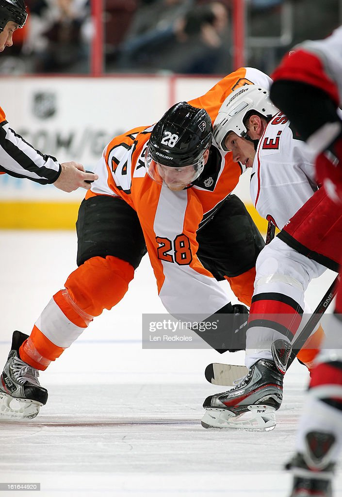 Claude Giroux #28 of the Philadelphia Flyers readies for a face-off against Eric Staal #12 of the Carolina Hurricanes on February 9, 2013 at the Wells Fargo Center in Philadelphia, Pennsylvania.