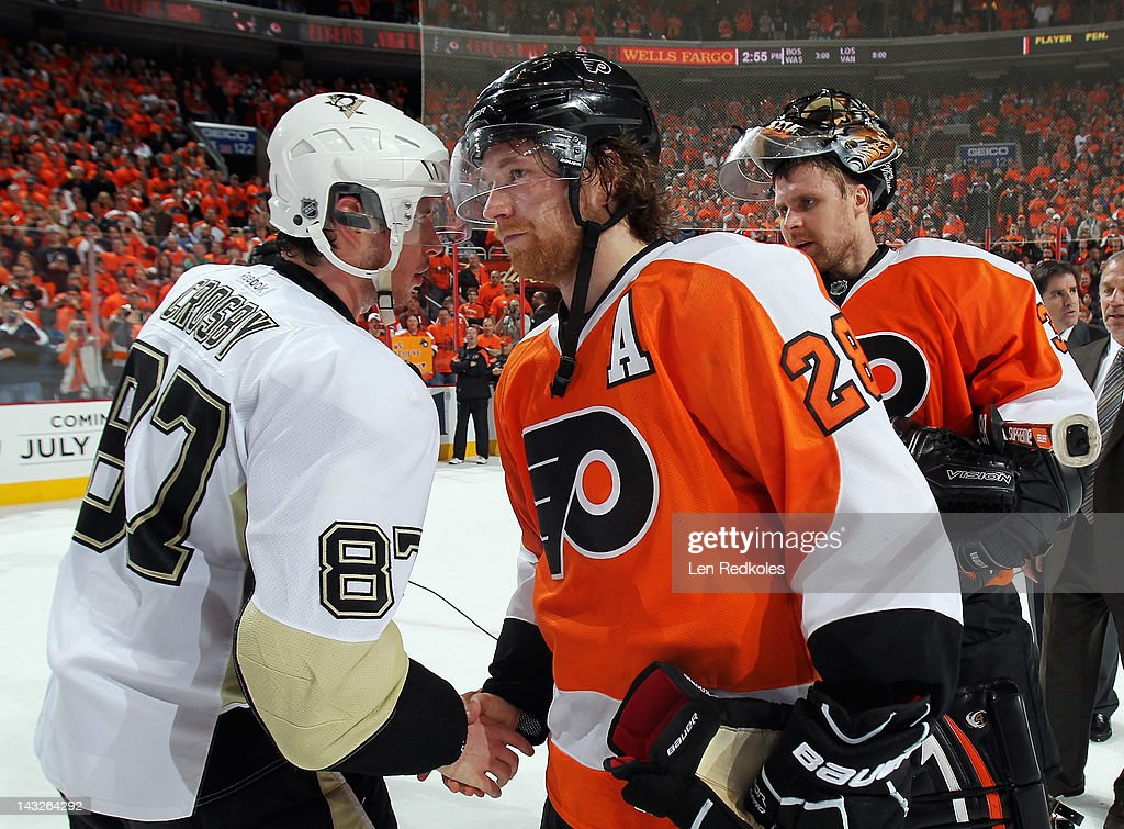 Claude Giroux #28 of the Philadelphia Flyers shakes hands with Sidney Crosby #87 of the Pittsburgh Penguins after Game Six of the Eastern Conference Quarterfinals during the 2012 NHL Stanley Cup Playoffs on April 22, 2012 at the Wells Fargo Center in Philadelphia, Pennsylvania. The Flyers defeated the Penguins 5-1 to win this series in six games.