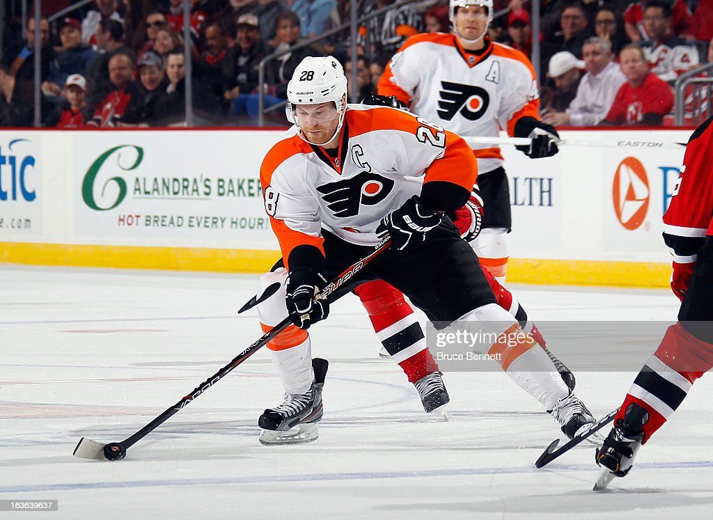 <a gi-track='captionPersonalityLinkClicked' href=/galleries/search?phrase=Claude+Giroux&family=editorial&specificpeople=537961 ng-click='$event.stopPropagation()'>Claude Giroux</a> #28 of the Philadelphia Flyers skates against the New Jersey Devils at the Prudential Center on March 13, 2013 in Newark, New Jersey. The Devils defeated the Flyers 5-2.