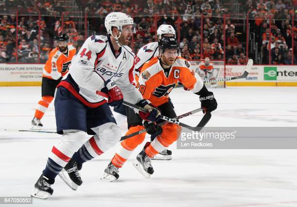 Claude Giroux of the Philadelphia Flyers skates between Brooks Orpik and Nicklas Backstrom of the Washington Capitals on February 22 2017 at the...