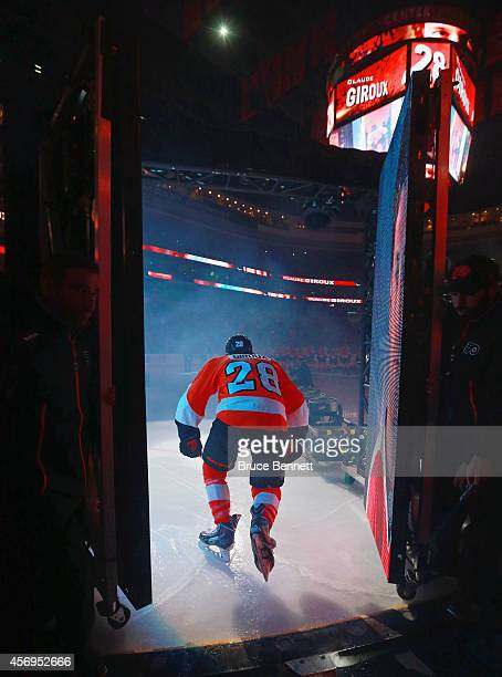 Claude Giroux of the Philadelphia Flyers skates out onto the ice during player introductions prior to the home opner against the New Jersey Devils at...