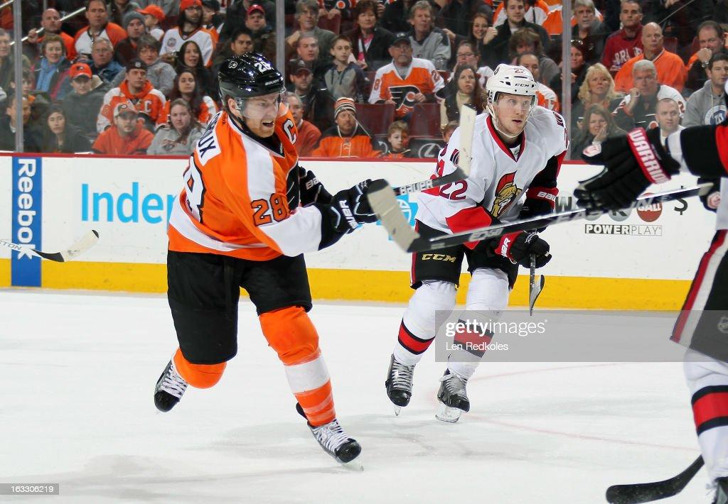 Claude Giroux #28 of the Philadelphia Flyers takes a slapshot against Erik Condra #22 of the Ottawa Senators on March 2, 2013 at the Wells Fargo Center in Philadelphia, Pennsylvania.