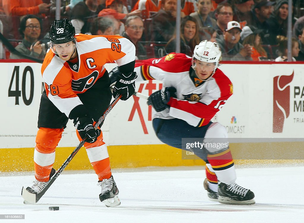 Claude Giroux #28 of the Philadelphia Flyers tries to keep the puck from Jack Skille #12 of the Florida Panthers on February 5, 2013 at the Wells Fargo Center in Philadelphia, Pennsylvania.