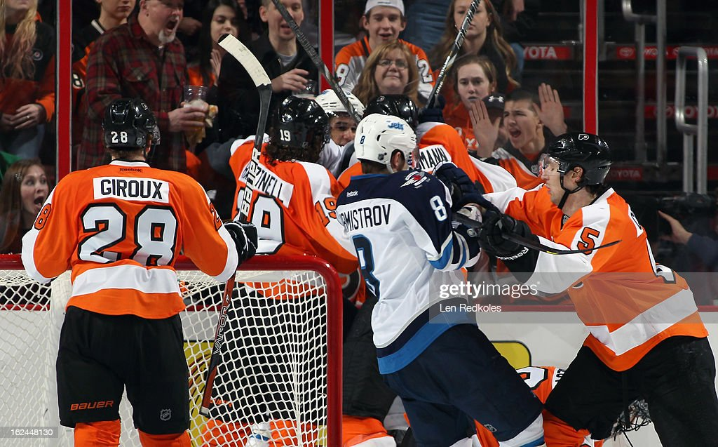 <a gi-track='captionPersonalityLinkClicked' href=/galleries/search?phrase=Claude+Giroux&family=editorial&specificpeople=537961 ng-click='$event.stopPropagation()'>Claude Giroux</a> #28 of the Philadelphia Flyers watches as a scrum develops behind the net against the Winnipeg Jets on February 23, 2013 at the Wells Fargo Center in Philadelphia, Pennsylvania. The Flyers went on to defeat the Jets 5-3.