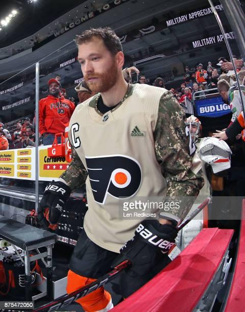 Claude Giroux of the Philadelphia Flyers wearing a camouflage jersey in honor of Military Appreciation night enters the ice surface for warmups...
