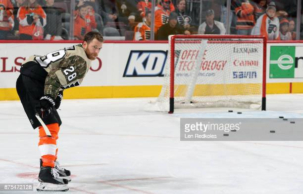 Claude Giroux of the Philadelphia Flyers wearing a camouflage jersey in honor of Military Appreciation night warms up against the Minnesota Wild on...