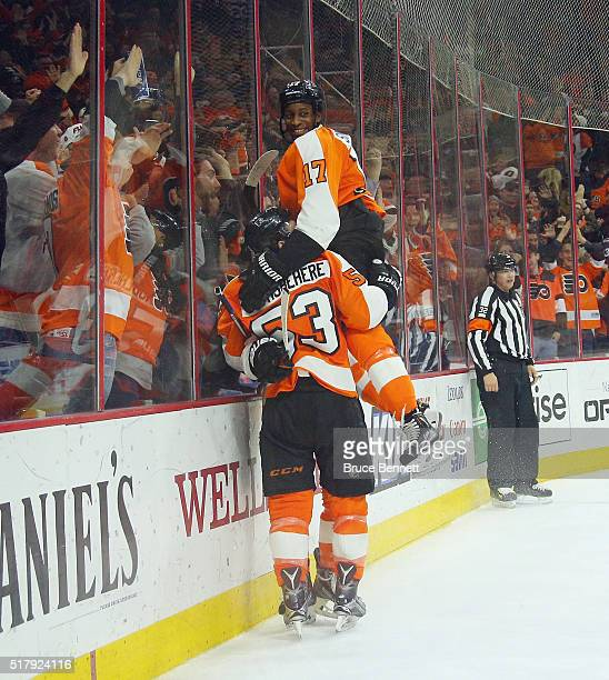 Claude Giroux Wayne Simmonds and Shayne Gostisbehere of the Philadelphia Flyers celebrate the game winning goal against the Winnipeg Jets at the...