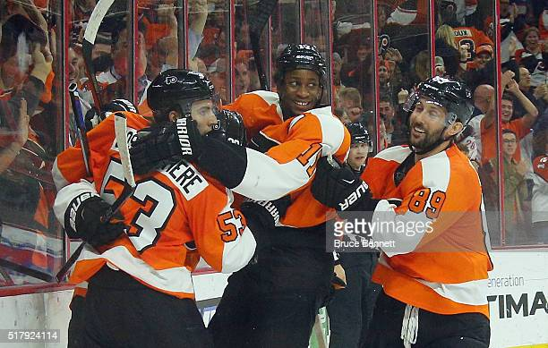 Claude Giroux Wayne Simmonds Shayne Gostisbehere and Sam Gagner of the Philadelphia Flyers celebrate the game winning goal against the Winnipeg Jets...