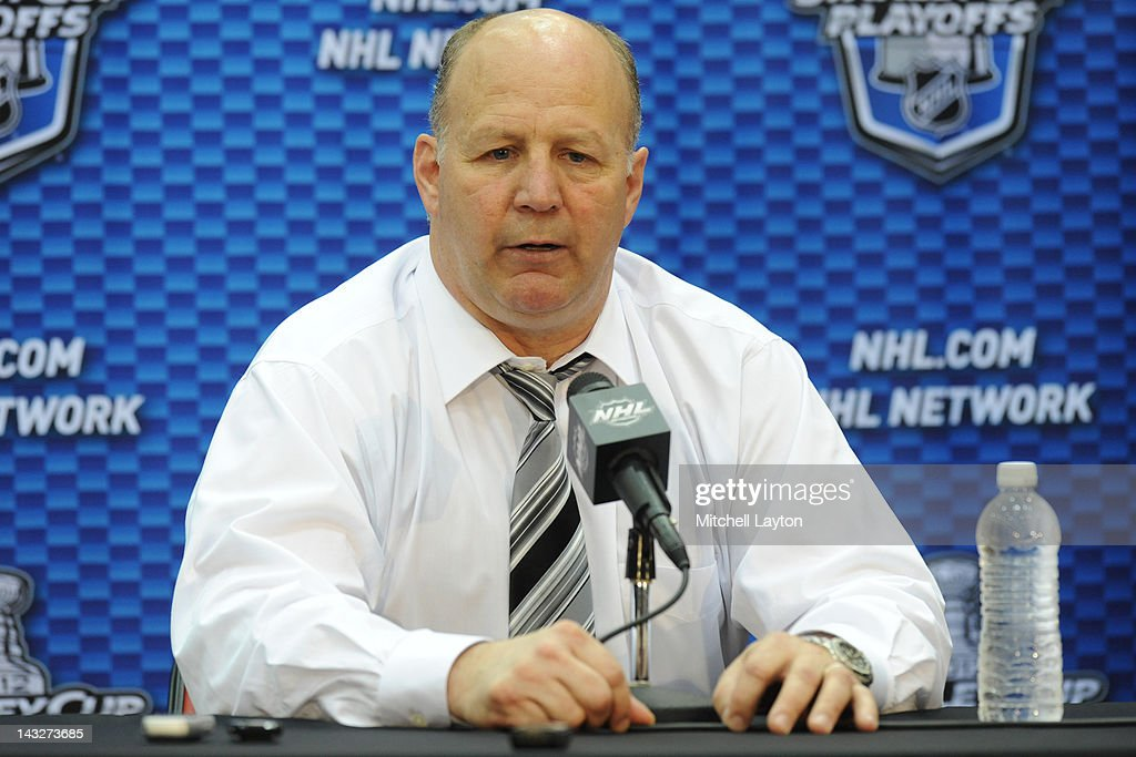 Claude Jean, Head Coach of the Boston Bruins, speaks during a press conference after Game Six of the Eastern Conference Quarterfinals of the 2012 NHL Stanley Cup Playoffs against the Washington Capitals on April 22, 2012 at the Verizon Center in Washington, DC.