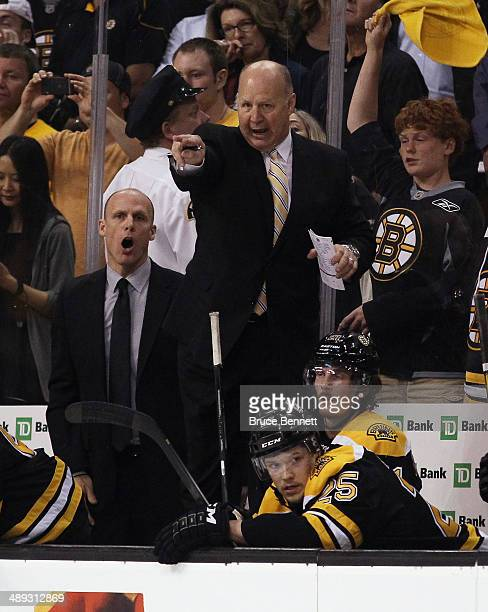 Claude Julien head coach of the Boston Bruins gives his players instructions during the game against the Montreal Canadiens during Game Five of the...