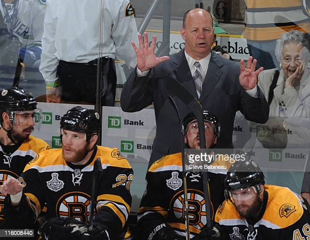 Claude Julien head coach of the Boston Bruins questions the referee during the game against the Vancouver Canucks in Game Six of the 2011 NHL Stanley...