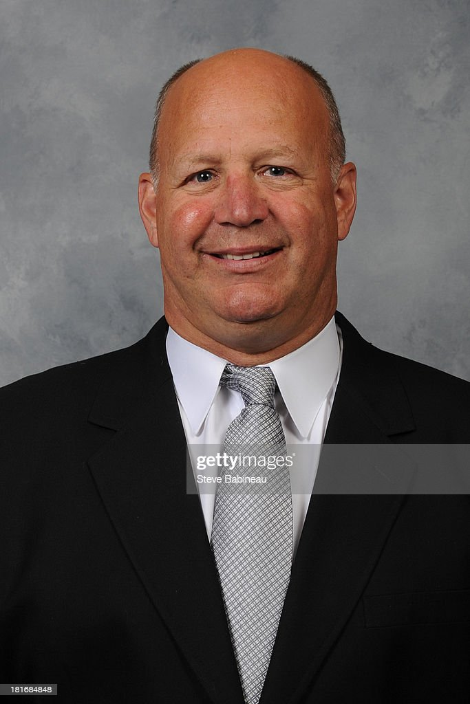 <a gi-track='captionPersonalityLinkClicked' href=/galleries/search?phrase=Claude+Julien&family=editorial&specificpeople=582124 ng-click='$event.stopPropagation()'>Claude Julien</a> of the Boston Bruins poses for his official headshot for the 2013-2014 season on September 12, 2013 at the TD Garden in Boston, Massachusetts.