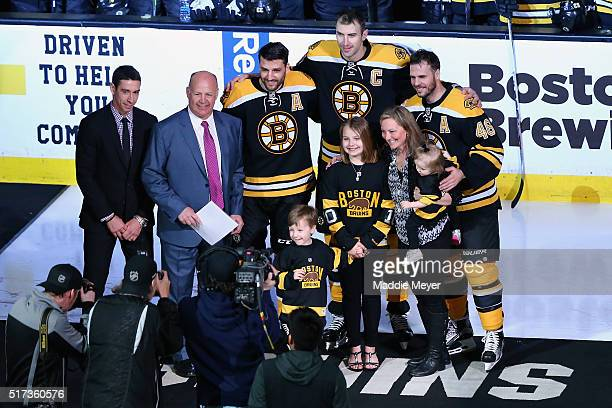 Claude Julien of the Boston Bruins with his wife Karen and daughters Katryna Chanel and Madyson and son Zachary is honored by Chris Kelly Patrice...