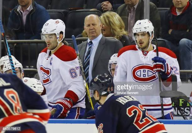 Claude Julien of the Montreal Canadiens handles bench duties during the third period against the New York Rangers at Madison Square Garden on...