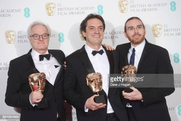 Claude La Haye Sylvain Bellemare and Bernard Gariepy Strobl pose with their awards for sound on the film 'Arrival' in the winners room at the 70th EE...