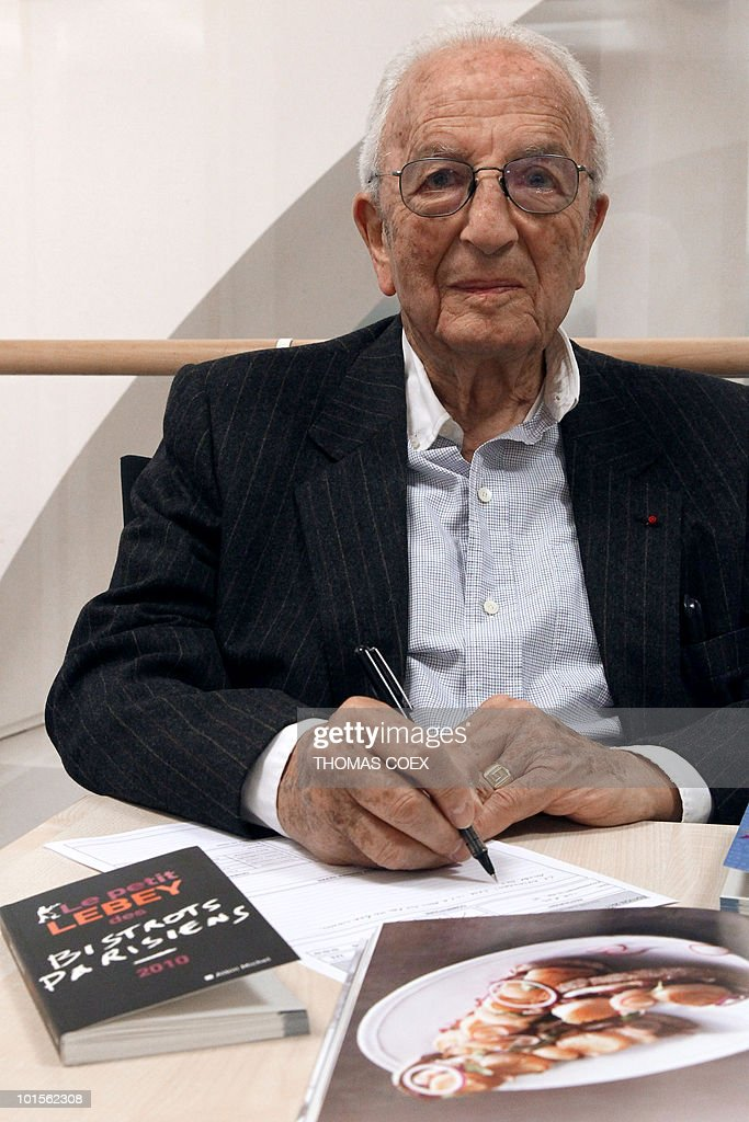 Claude Lebey, French gastronomy critic and author of guidebooks poses with his guide 'Le petit Lebey des bistrots parisiens', on May 17, 2010, at French publisher Albin Michel office, in Paris. The guide, released in France on February 4, 2010, lists 400 'cafes' in Paris.