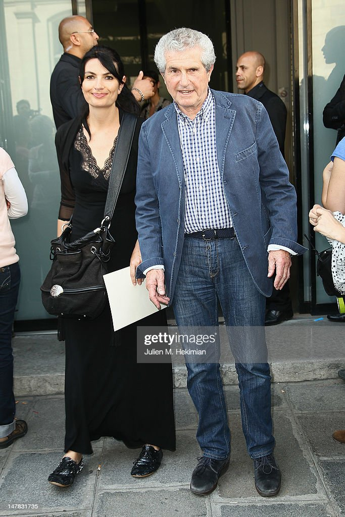 <a gi-track='captionPersonalityLinkClicked' href=/galleries/search?phrase=Claude+Lelouch&family=editorial&specificpeople=207051 ng-click='$event.stopPropagation()'>Claude Lelouch</a> and his guest attend the Jean-Paul Gaultier Haute-Couture Show as part of Paris Fashion Week Fall / Winter 2012/13 on July 4, 2012 in Paris, France.