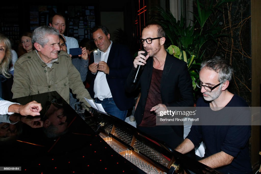 Claude Lelouch listens to Calogero and Vincent Delerm, who wrote a song especially for him, during Claude Lelouch celebrates his 80th Birthday at Restaurant Victoria on October 30, 2017 in Paris, France.