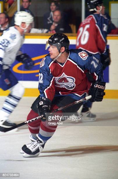 Claude Lemieux of the Colorado Avalanche turns up ice against the Toronto Maple Leafs during game action on December 11 1995 at Maple Leaf Gardens in...