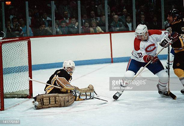 Claude Lemieux of the Montreal Canadiens attempts to score during a game against the Boston Bruins Circa 1980 at the Montreal Forum in Montreal...