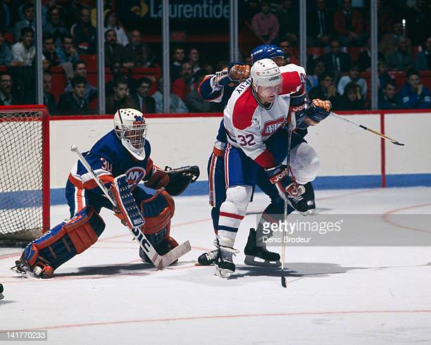 Claude Lemieux of the Montreal Canadiens fights for position in front of the net against the New York Islanders Circa 1980 at the Montreal Forum in...