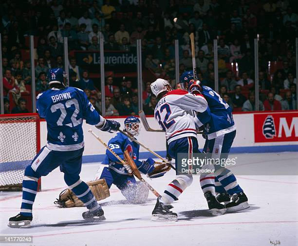 Claude Lemieux of the Montreal Canadiens fights for position in front of the net against the Quebec Nordiques Circa 1980 at the Montreal Forum in...