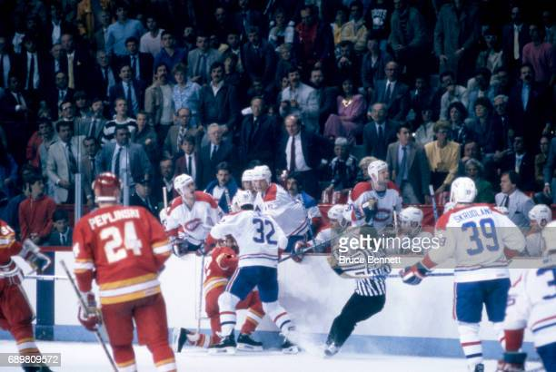 Claude Lemieux of the Montreal Canadiens hits John Tonelli of the Calgary Flames during a game in the 1986 Stanley Cup Finals circa May 1986 at the...