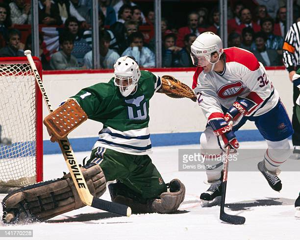 Claude Lemieux of the Montreal Canadiens looks for a loose puck near the net during a game against the Hartford Whalers Circa 1980 at the Montreal...