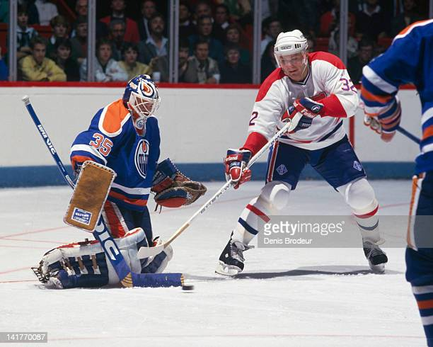 Claude Lemieux of the Montreal Canadiens redirects the puck on goal during a game against the Edmonton Oilers Circa 1980 at the Montreal Forum in...