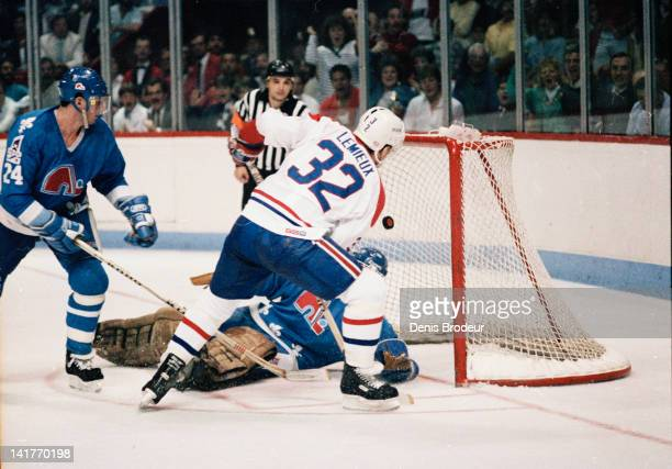 Claude Lemieux of the Montreal Canadiens scores a goal during a game against the Quebec Nordiques Circa 1980 at the Montreal Forum in Montreal Quebec...