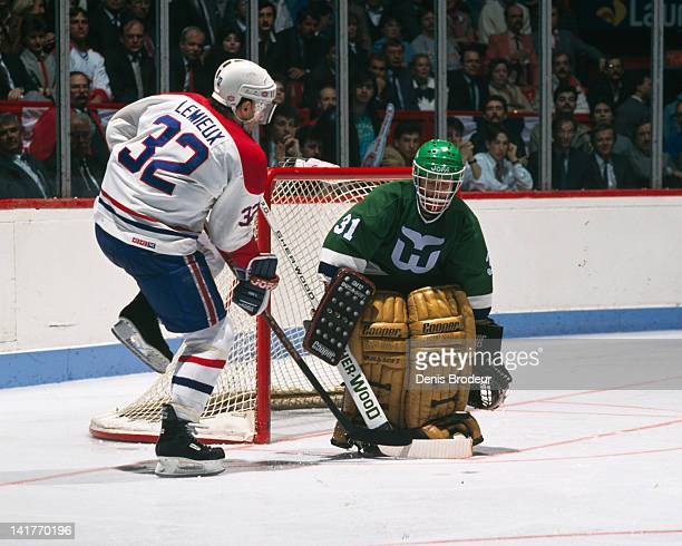 Claude Lemieux of the Montreal Canadiens shoots the puck on goal during a game against the Hartford Whalers Circa 1980 at the Montreal Forum in...