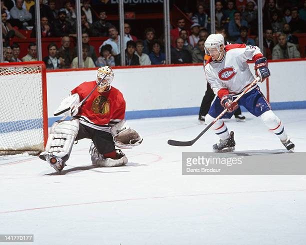 Claude Lemieux of the Montreal Canadiens shoots the puck on net against the Chicago Blackhawks Circa 1980 at the Montreal Forum in Montreal Quebec...