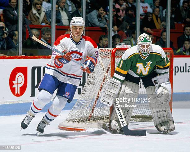 Claude Lemieux of the Montreal Canadiens skates past Kari Takko of the Minnesota North Stars during a game Circa 1986 at the Montreal Forum in...