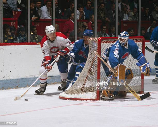 Claude Lemieux of the Montreal Canadiens skates the puck behind the net during a game against the Quebec Nordiques Circa 1980 at the Montreal Forum...