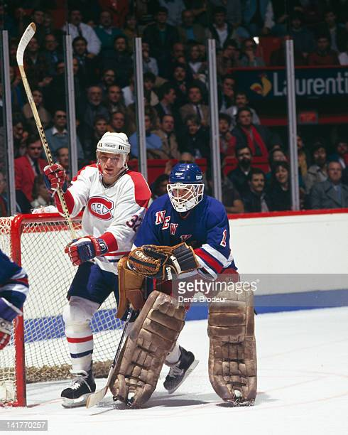 Claude Lemieux of the Montreal Canadiens skates through the crease during a game against the New York Rangers Circa 1980 at the Montreal Forum in...