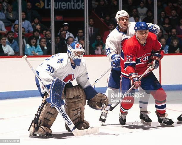 Claude Lemieux of the Montreal Canadiens skates to the front of the net during a game against the Quebec Nordiques Circa 1980 at the Montreal Forum...