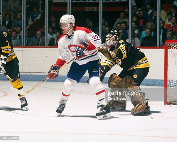 Claude Lemieux of the Montreal Canadiens stands in front of the net against the Boston Bruins Circa 1980 at the Montreal Forum in Montreal Quebec...