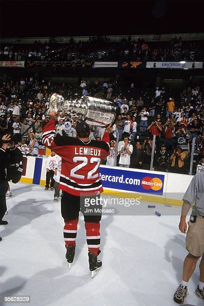 Claude Lemieux of the New Jersey Devils celebrates with the Stanley Cup Trophy as he skates around the rink after winning the 2000 Stanley Cup Finals...