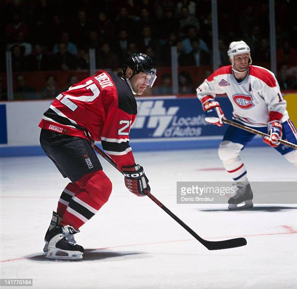 Claude Lemieux of the New Jersey Devils stands at the faceoff circle during a game against the Montreal Canadiens Circa 1990 at the Montreal Forum in...