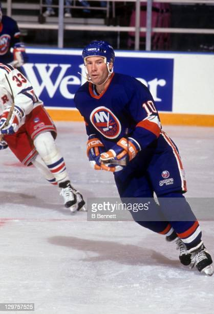 Claude Loiselle of the New York Islanders skates on the ice during an NHL preseason game against the New York Rangers in September 1992 at the...