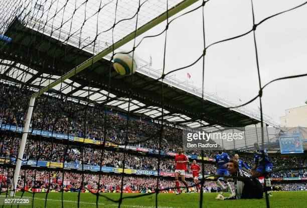 Claude Makelele of Chelsea misses a penalty but gets his own rebound to score the winning goal in the final seconds during the Barclays Premiership...