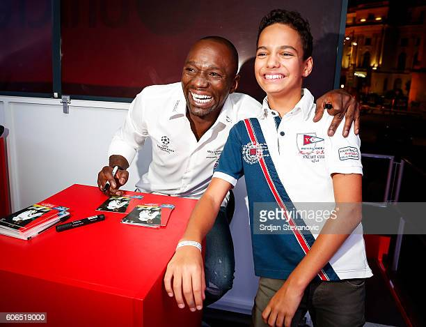 Claude Makelele pose with the fan during the UEFA Champions League Trophy Tour presented by UniCredit at Atheneum Square on September 16 2016 in...
