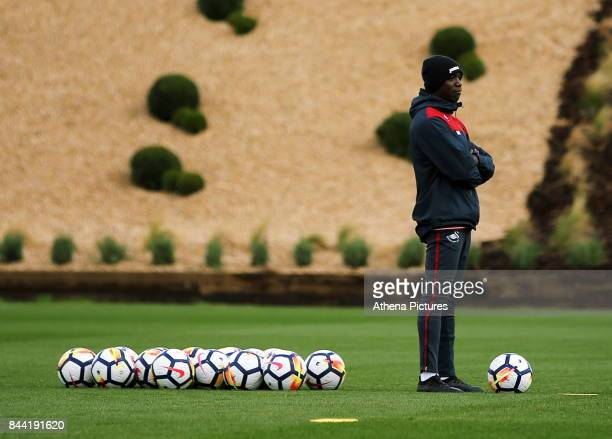 Claude Makelele Swansea assistant coach watches the players rain during the Swansea City Training at The Fairwood Training Ground on September 08...